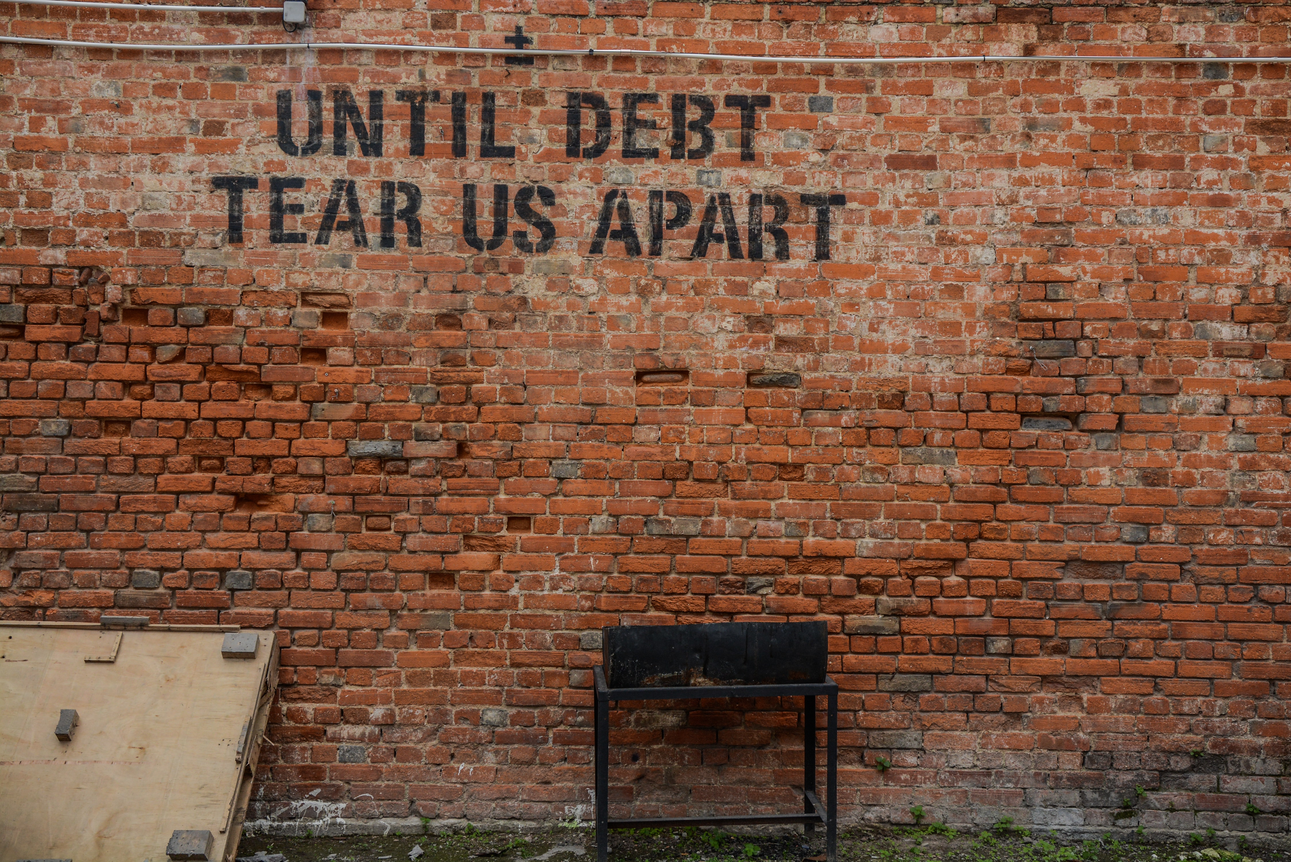 debt; Photo by Alice Pasqual on Unsplash