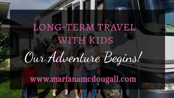 Long-Term Travel with kids: Our Adventure Begins!, www.marianamcdougall.com, photo of RV with family of 5 in front.