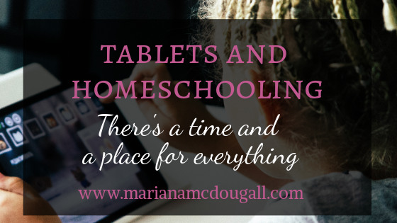 Tablets and homeschooling: there's a time and a place for everything. Pink and white text against a black background, with child using tablet behind.