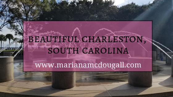 Blog Title in black and white letters against a faint pink background: Beautiful Charleston, South Carolina, www.marianamcdougall.com. Picture of a fountain in Charleston in the background.
