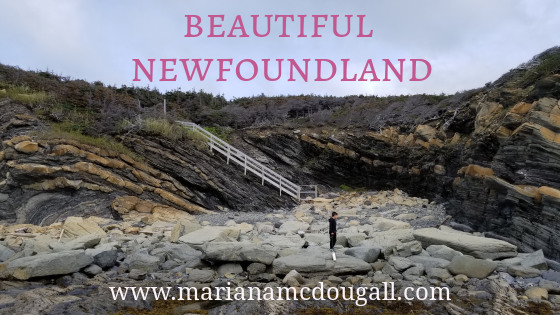 Beautiful Newfoundland, www.marianamcdougall.com, boy playing with wooden boat in front of rocks at Gros Morne National Park (near Lightkeeper's house)