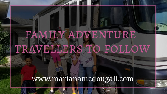 family adventure travellers to follow, www.marianamcdougall.com, pink and white text on faint black background, in front of picture of a mother, father, and three children standing by an RV.