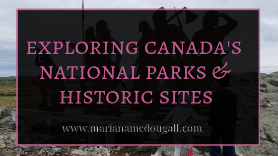 Exploring Canada's National Parks & Historic Sites, www.marianamcdougall.com, white and pink text on faint black background and pink border, in front of picture of two children climbing to statues of Vikings (Norse people).