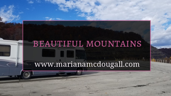 "Blog Title Image, pink and white lettering on faint black background: ""Beautiful Mountains, www.marianamcdougall.com."" RV inn front of mountains near Sommersville, PA"