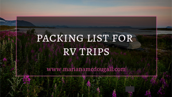 Packing list for RV Trips. Background Vidar Nordli-Mathisen shows a motorhome in front of a body of water, with many purple flowers in front of the RV.